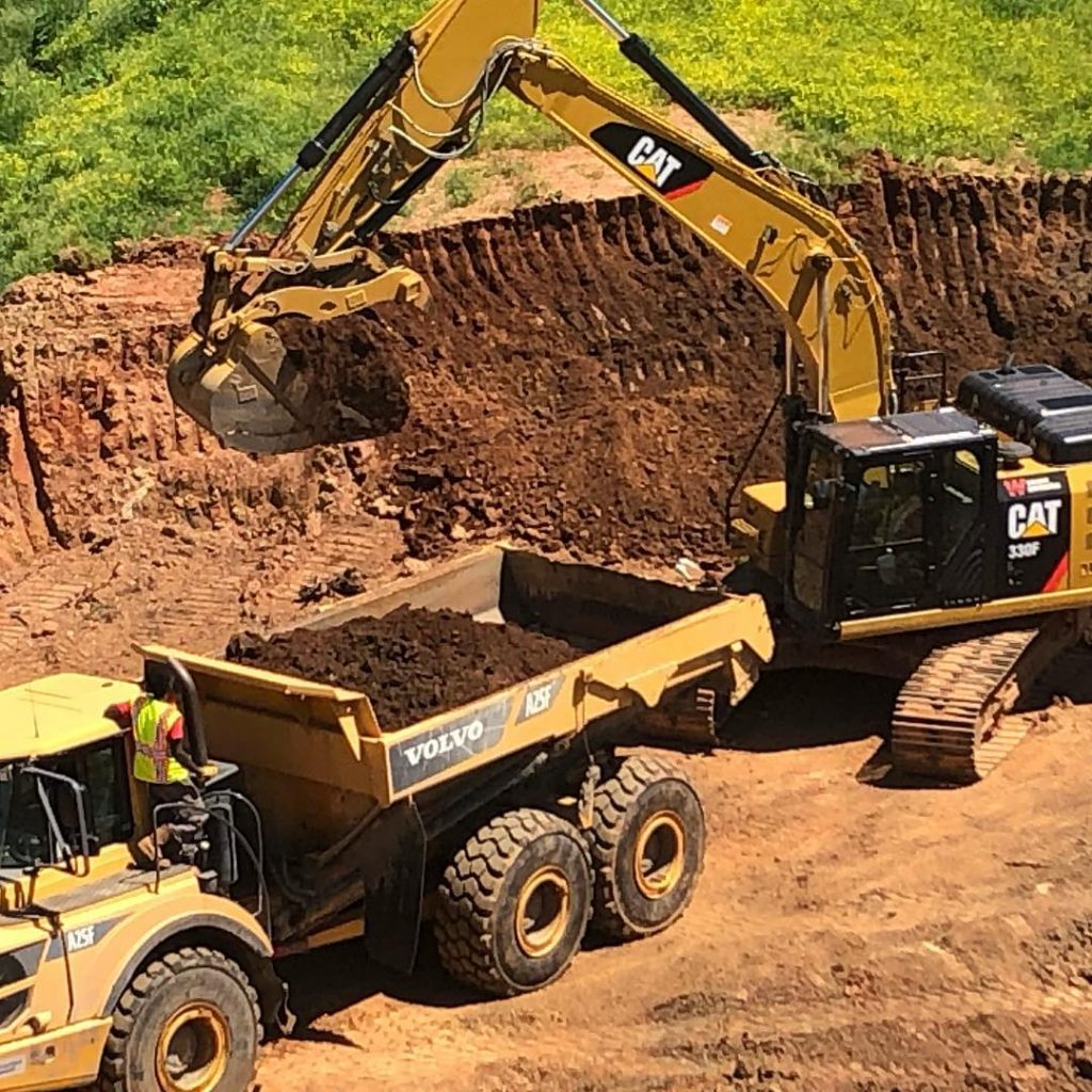 Construction equipment in a dirt hole